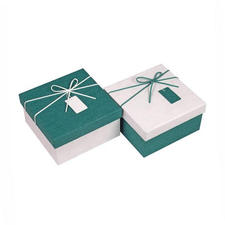 Handmade luxury specialty paper logo custom ribbon box lid and base paper box